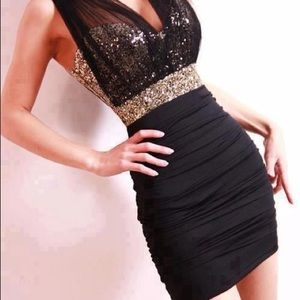 Dresses & Skirts - Black and Gold Sequin body con dress